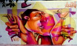 Lelin Alves paints a mural man who is content with his relationship with nature