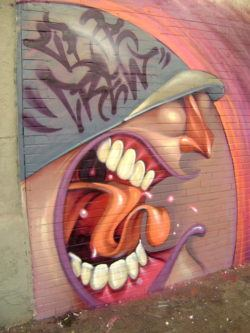 Lelin Alves uses the artistic technique of exaggeration to make this shouting graffiti character appear super angry