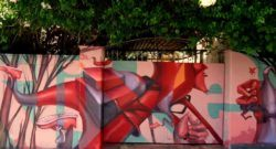 The crazy perspective used in this street art mural of a skydiver is a signature aspect of Lelin Alves' graffiti art style
