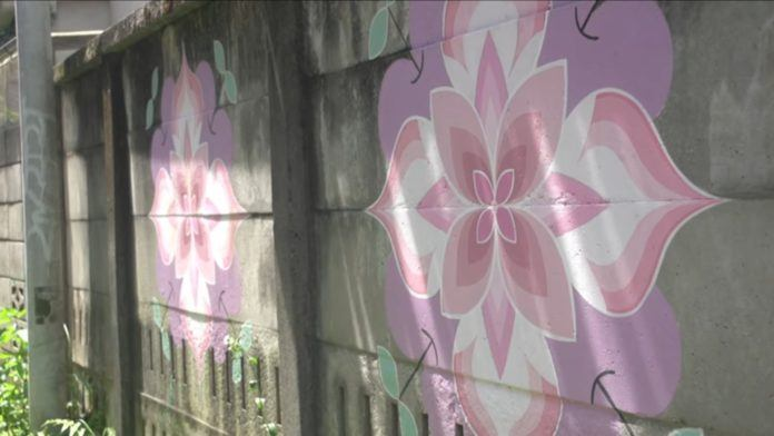 This pink mandala flower wall mural is by the Japanese street artists and romantic couple Hitotzuki