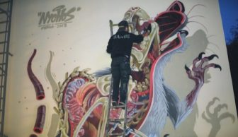 Watch Street Artist Nychos Paint a Gruesome Wall Mural