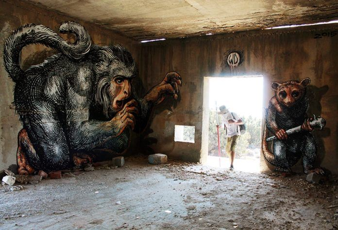 A monkey and a marsupial lie in wait for unsuspecting vivstors in this funny graffiti mural by Wild Drawing