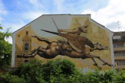 An adventurous monkey rides a flying horse in this street art mural in Germany by Wild Drawing