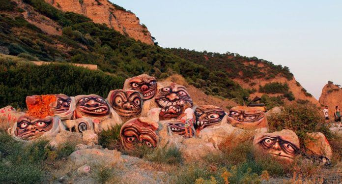 Concrete monsters rise up from the ground in this Greek art installation by Wild Drawing