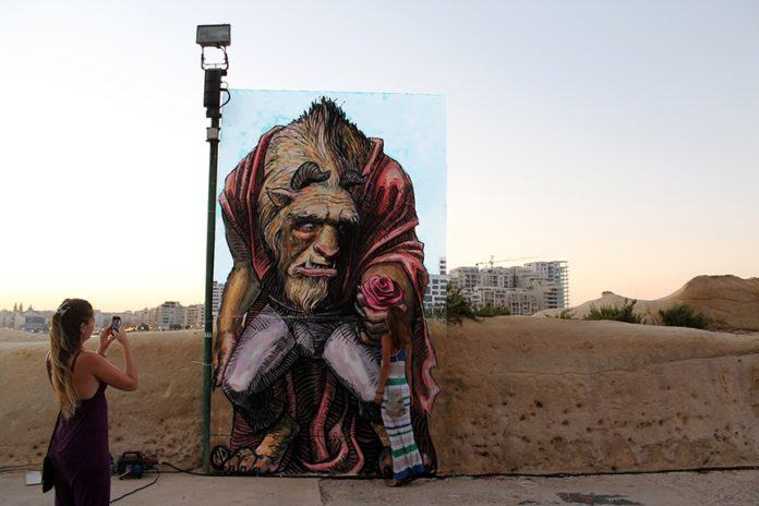 Wild Drawing's street art mural in Malta shows a broken hearted Beast