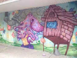 Another wooden house is featured in this graffiti mural by street artist Ekundayo