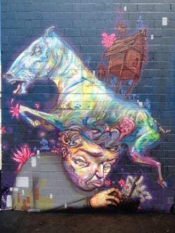 Hawaiian street artist Ekundayo combine fine art and graffiti techniques in this wall mural of a man and a horse