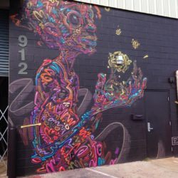 Street artist Ekundayo wows the public with this brightly colored wall mural called Gifts