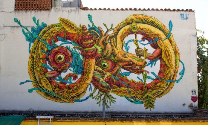 This street art mural by Gonzalo Areúz shows Xiuhcoatl, the fire serpent in Aztec mythology
