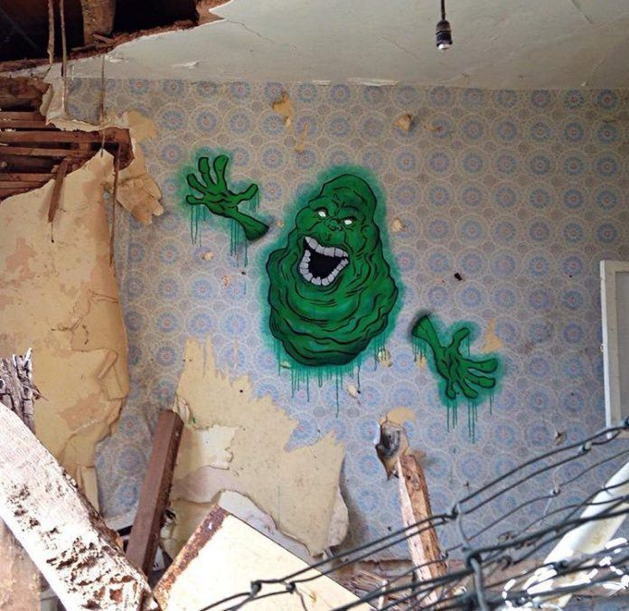 This evil spirit that seems to be haunting this house by appearing through the walls is Slimer by NME1