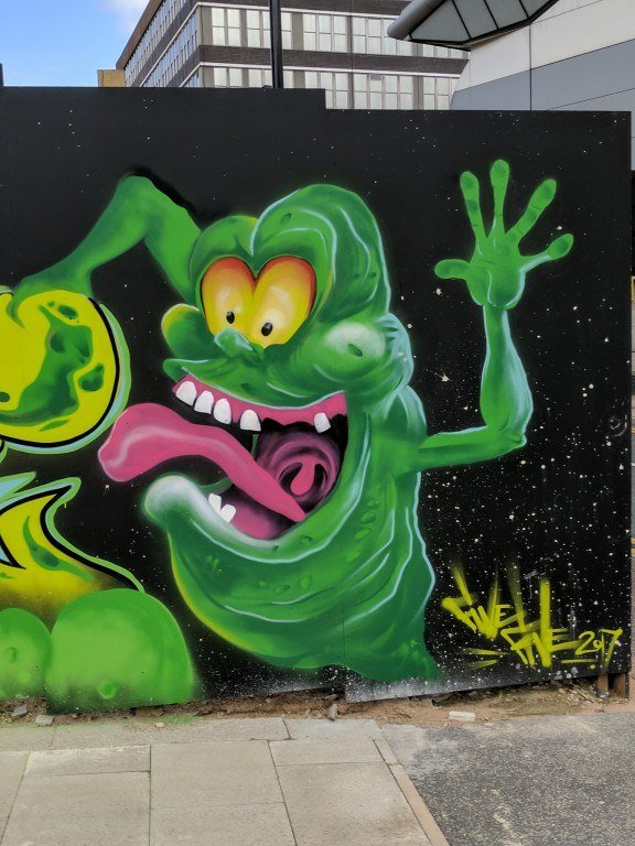 This wall mural of Slimer shows the ghost's face the way that most 80s kids remember him; with a big stupid hungry grin