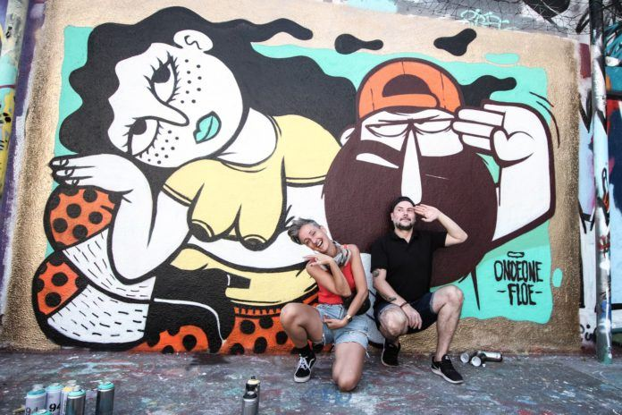 Street artist Floe poses with OndeOne, her collaborator on this pop art graffiti mural