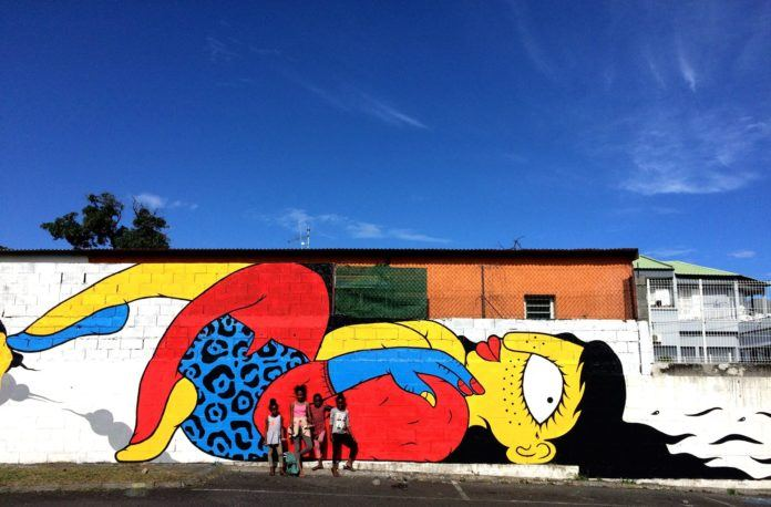 These children give an idea of how large this wall mural of a flirty lady by Floe really is.